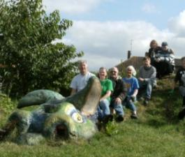 Milton Keynes Green Gym and Wolverton Community Orchard Group volunteers on top of the 'dragon mountain'