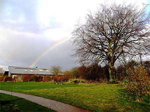 Skelton Grange Environment Centre with a rainbow behind it
