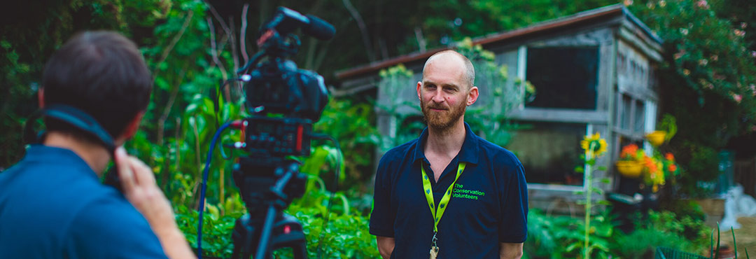 Man standing in front of a video camera