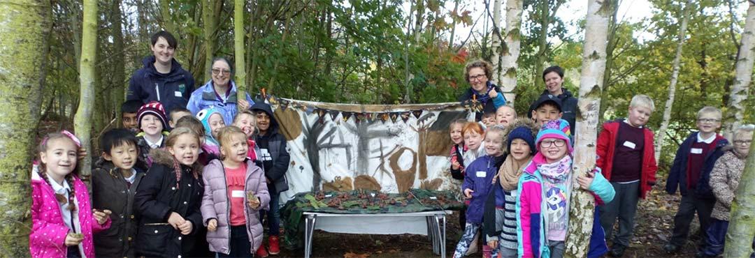 Children having fun in a woodland setting