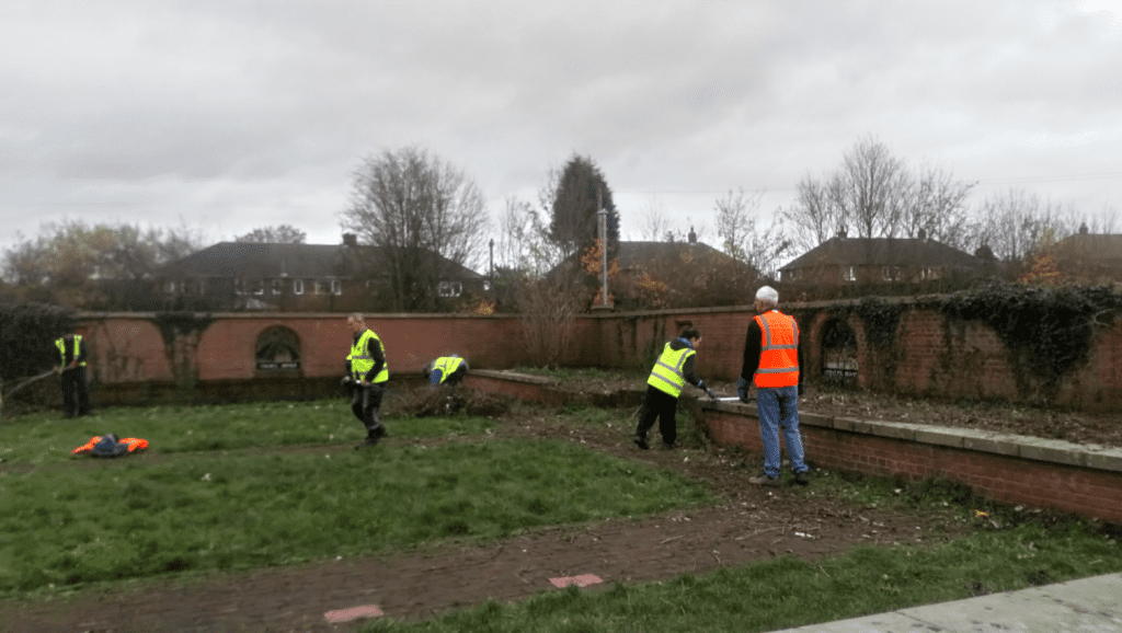 Volunteers spread out clearing some land