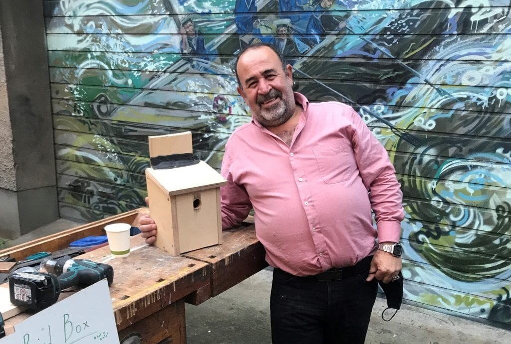 Volunteer with bird box