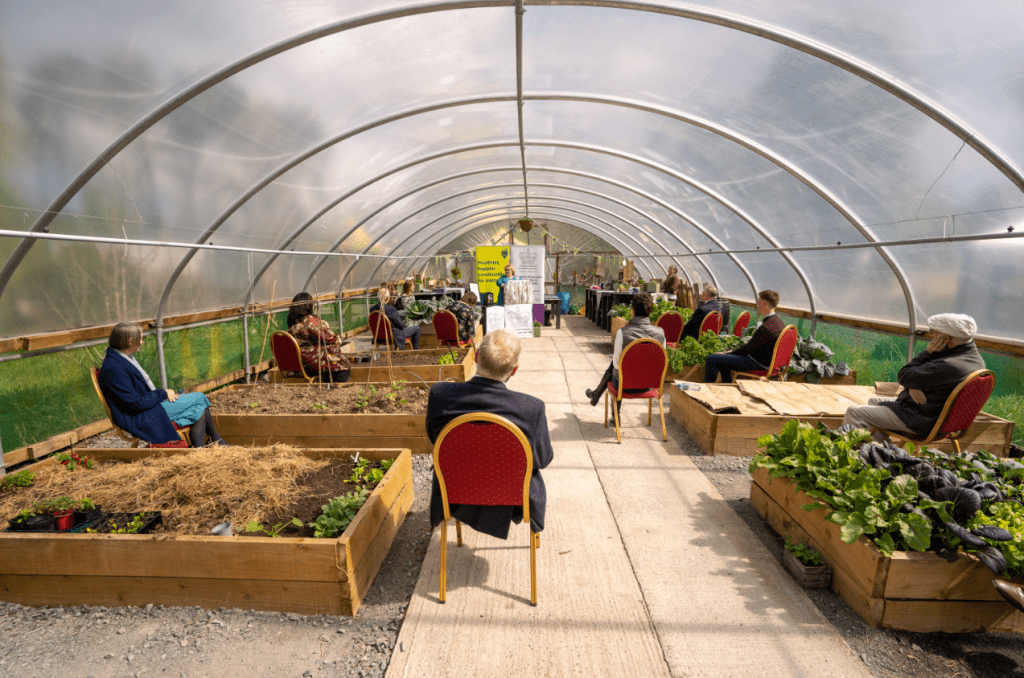 QAVS Belfast celebration event in polytunnel with Lord Lieutenant