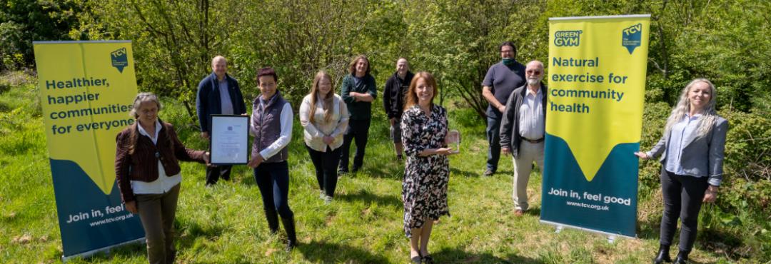 QAVS Belfast volunteers and staff with award